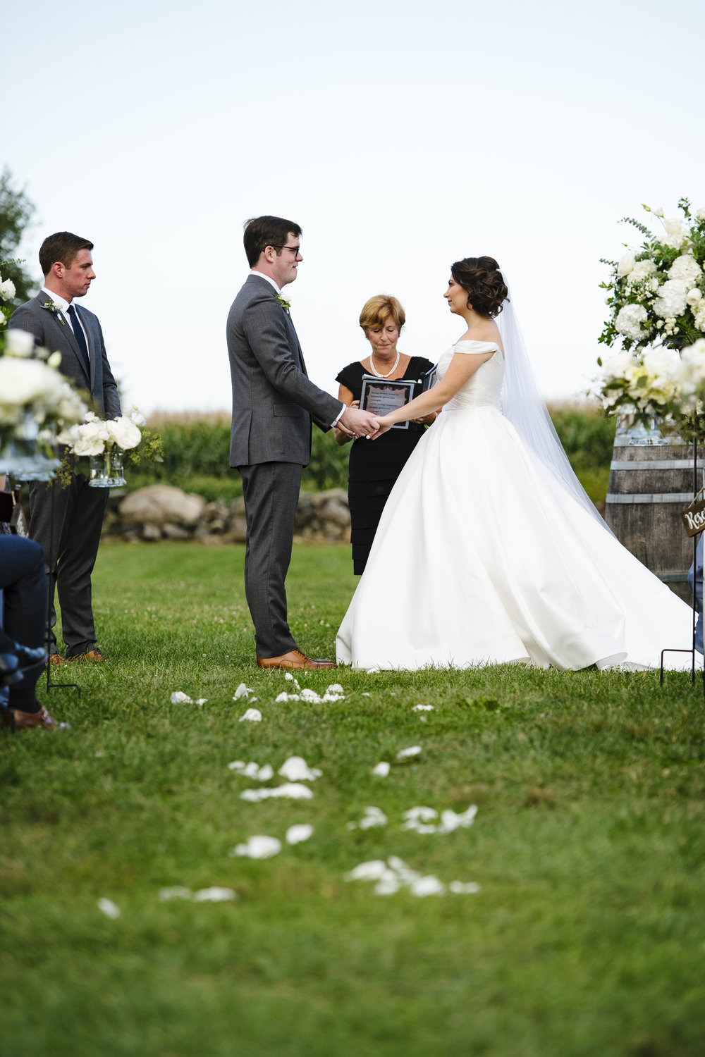 Bride and groom standing at the altar on their wedding day at jonathan edwards winery - Pearl Weddings & Events