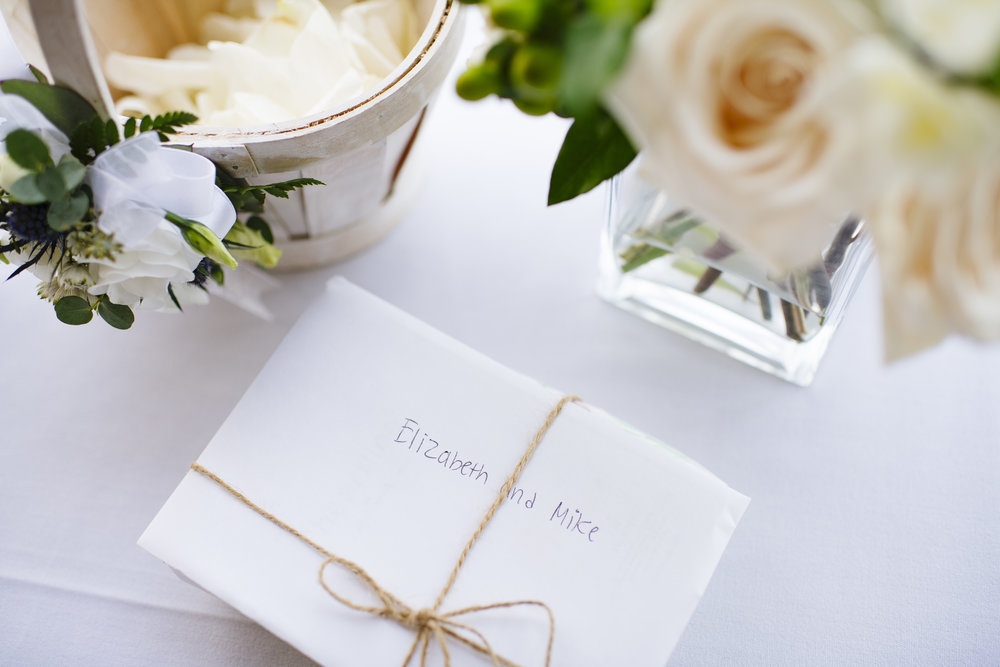 White rose wedding details and gift table at Jonathan Edwards Winery - Pearl Weddings & Events