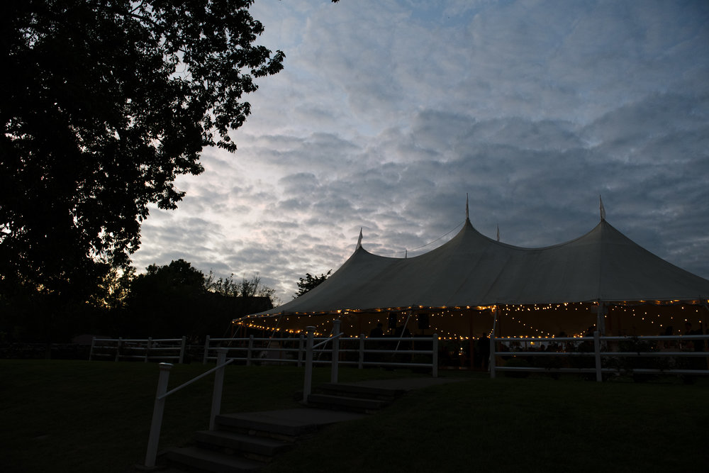 Beautiful skies with a sperry tent outside for a Jonathan Edwards Winery wedding in Connecticut - Pearl Weddings & Events