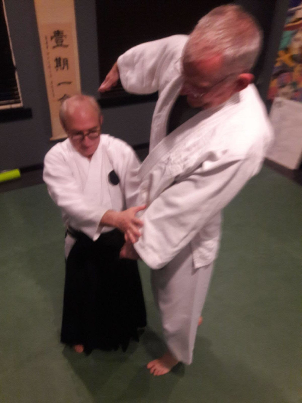 Goldberg Sensei demonstrating aiki age on Cory Juhl. Size is no obstacle in Daito Ryu.