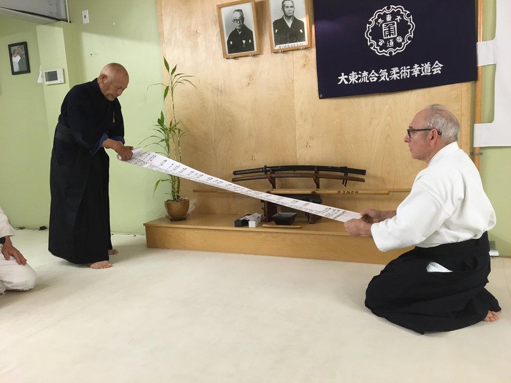 Goldberg Sensei receiving the Hi Ogi, the 3rd Scroll in the Daito Ryu transmission from Kiyama Shihan. — June, 2016