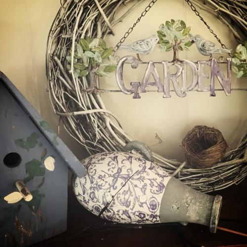 Birdhouses and bottles bring the freshness of April inside.