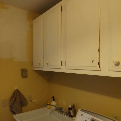 BEFORE: Broken doors, missing knobs and shelves too high meant these cabinets were not only out of reach, they were outta here!