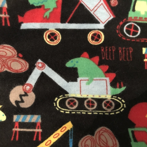 Sweet dreams on a soft flannel pillowcase teaming with dinosaur operated excavators!
