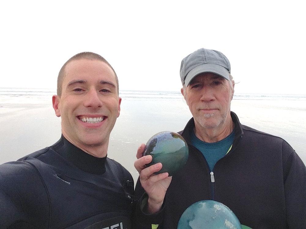 Roger & Trevor Crosta holding floats on the beach