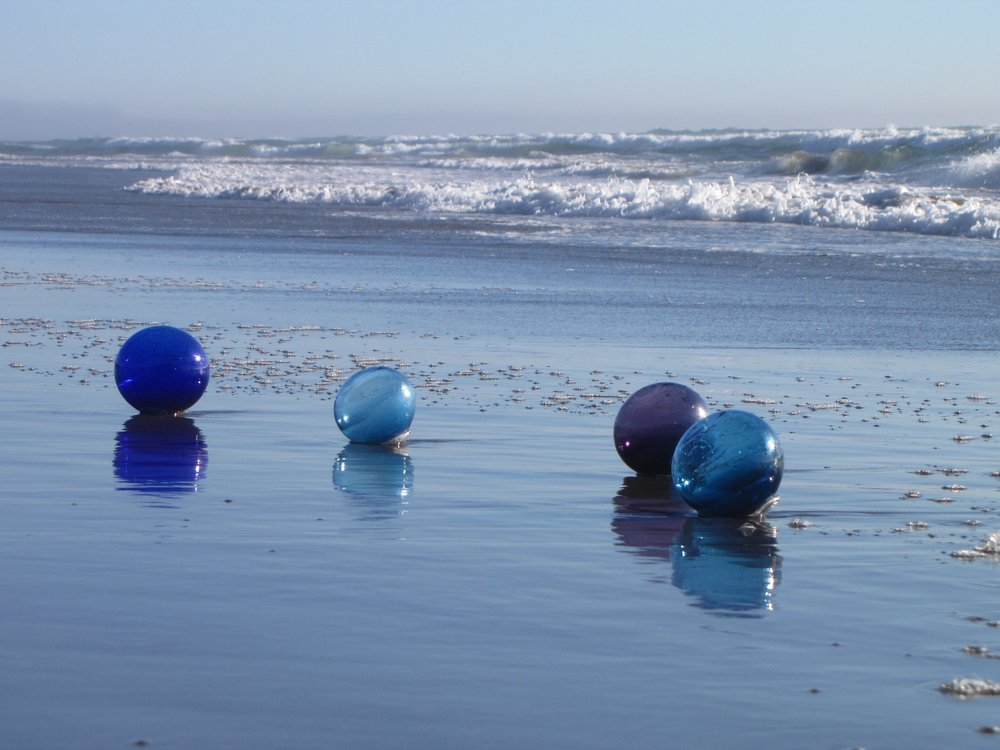 The Float Hunt Project blown glass floats washed up on manzanita beach