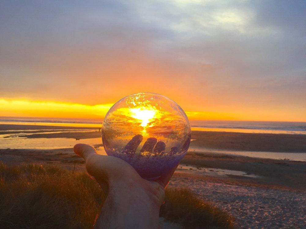 beautiful sunset on manzanita beach with a fishing float