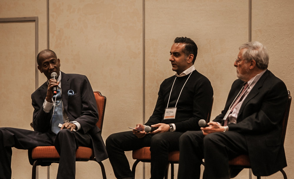 """Carl Baty (left) during """"one of the most contentious moments during the symposium"""", with Pritpal S Tamber (center) and S Leonard Syme (right) (Photo by Nicolle Bennett)"""