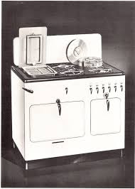 Front view of Model B Chambers vintage stove with black cooktop showing broiler under griddle and pots in Thermo-Well
