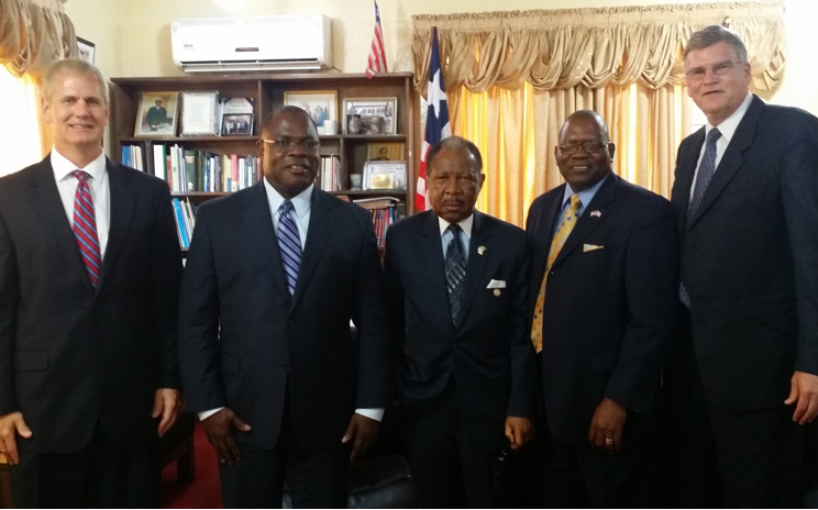 L to R: Randy Carman, Elijah Tarpeh, Dr. Emmet A. Dennis (President, University of Liberia), Zackery Major, Gary Friesen