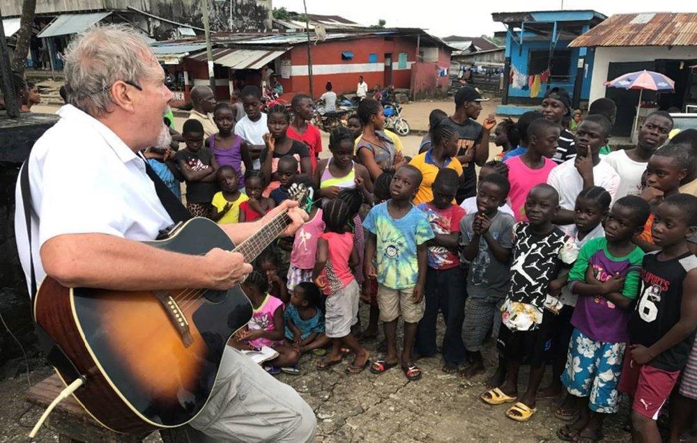 Ace guitar with kids.jpg