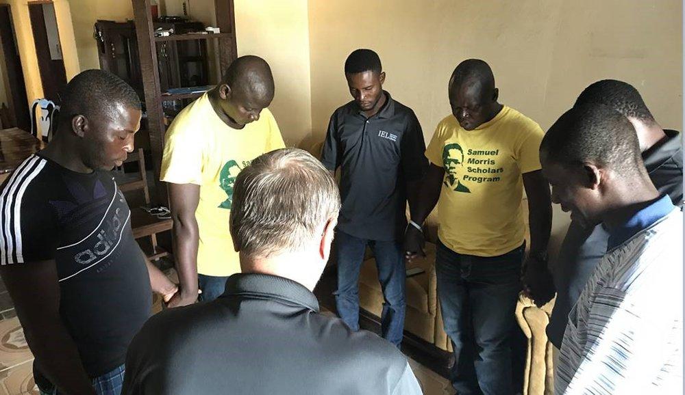 Praying team.jpg