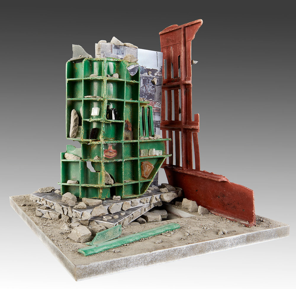 "'Antilogos I'   Artwork based on Yazan Homsy/Reuters photograph ""The Destruction of Homs"" (January 27, 2014)   Wood, Recycled Plastic, Paper, Cement, Glass, Agate, Calcite, Aegirine"