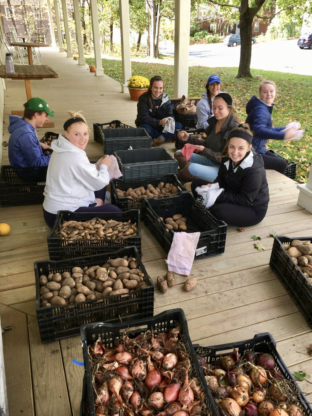 Colby-Sawyer College students doing their homework for a class on food systems.