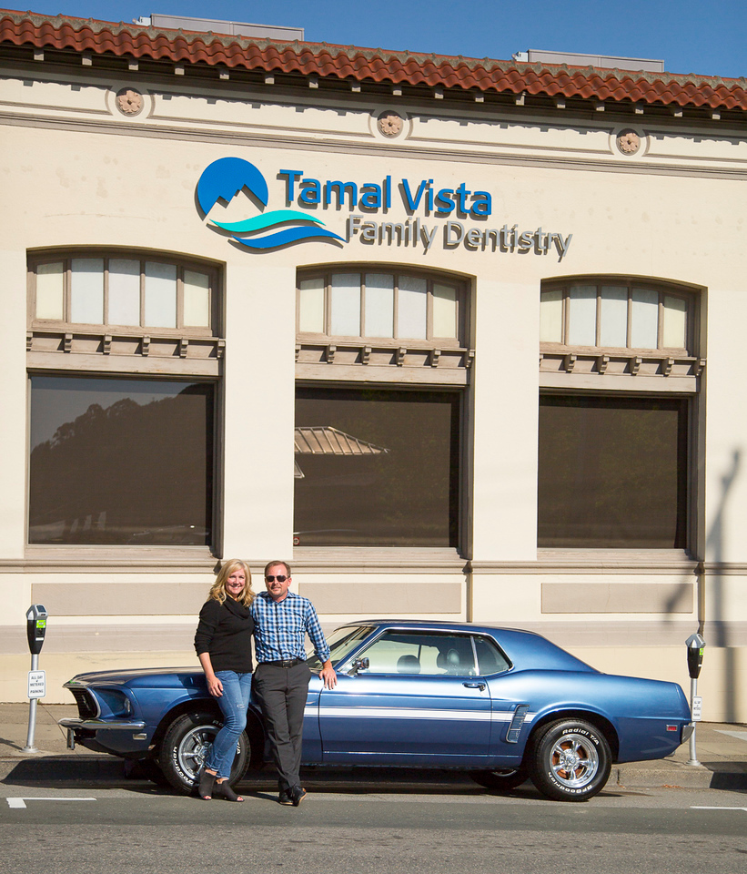"Dr. James and Cristy McDowell in front of their San Rafael office with their beloved ""Laverne""."