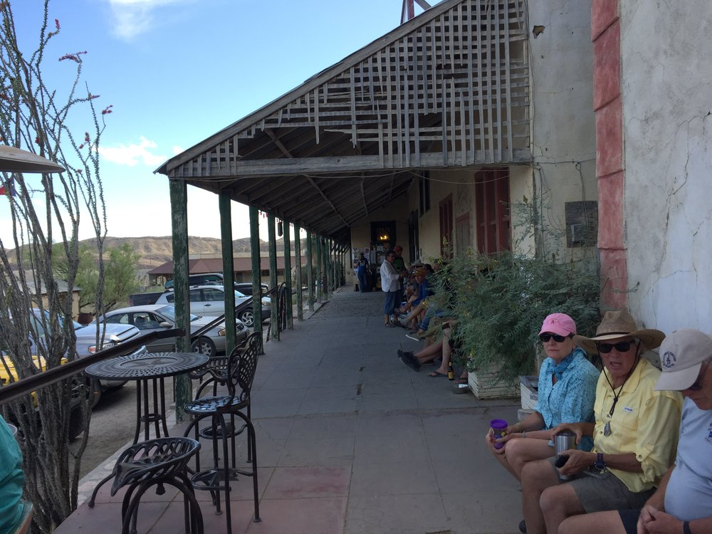 Everyone gathers for a beer on the porch