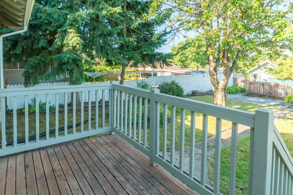 Backyard deck accessed through convenient mudroom.
