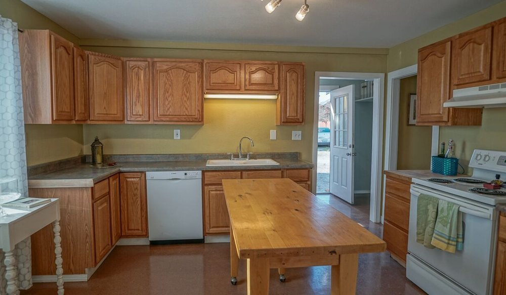 Spacious kitchen is convenient, clean, and ready to go.