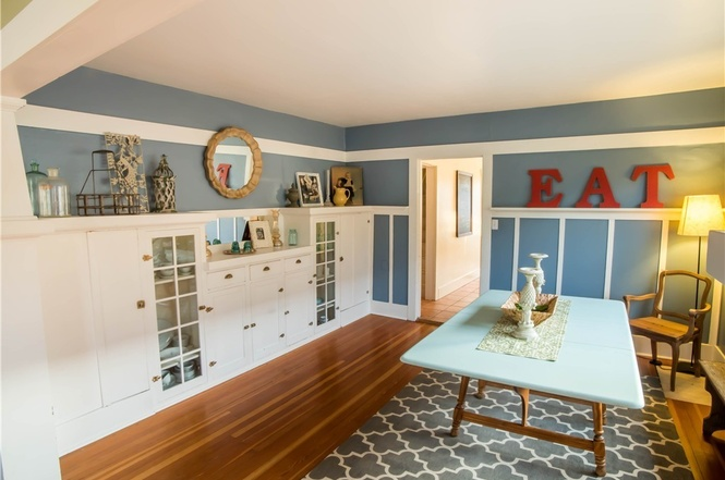 Beautiful dining room with built-in cabinets to display heirlooms, and favorite dishes.