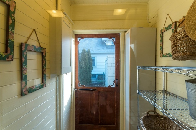 Classic mud room leads into kitchen from the backyard.