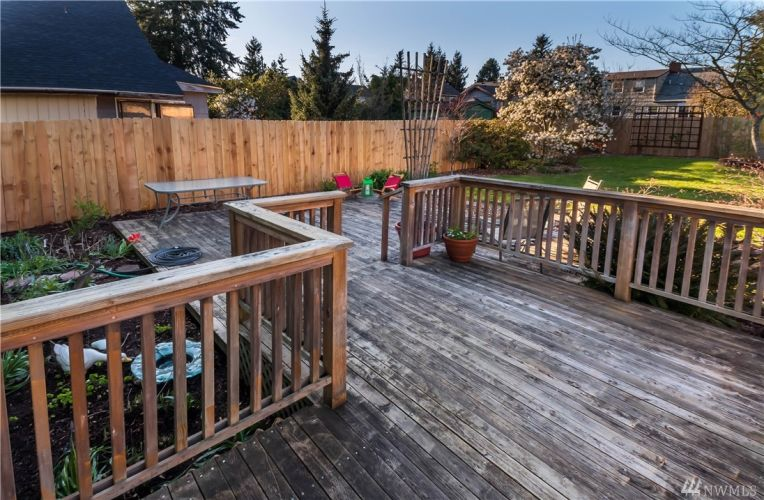 Large deck from kitchen and new cedar fence.