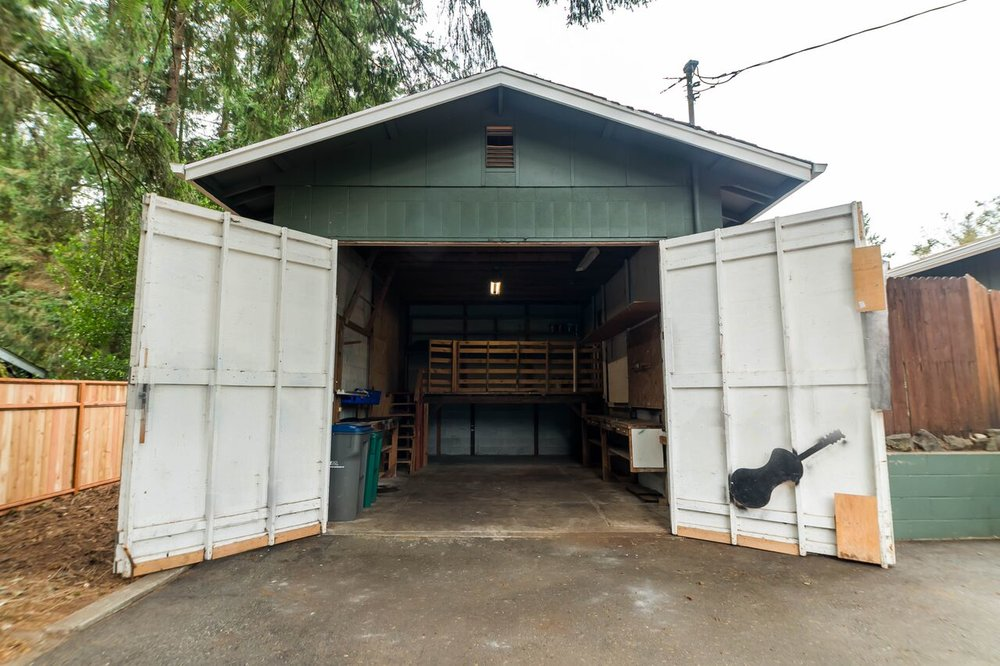 Detached garage/workshop with a loft entrance as well as these wide front doors where vehicles or boats can enter.