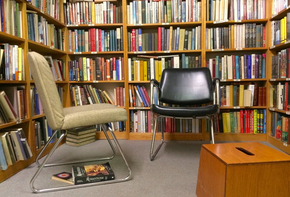 Cozy reading area in the hardback literature section at Tacoma Book Center.