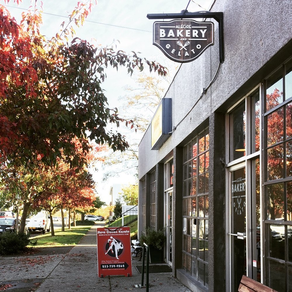 Outside Alegre (tucked between Playback Sports and the Academy of Steve Curran Karate) on a bright fall day.
