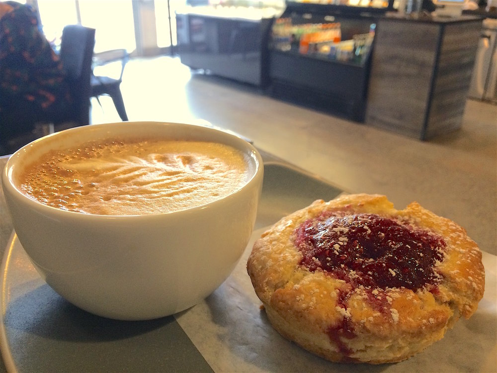 Warm scone with raspberry jam and a latte. The jam tasted bright with a little bit of lemon, like homemade freezer jam.