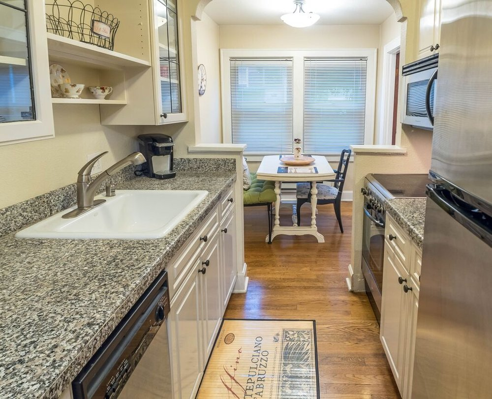 Walk through from a small foyer into this well-appointed kitchen complete with stainless appliances.