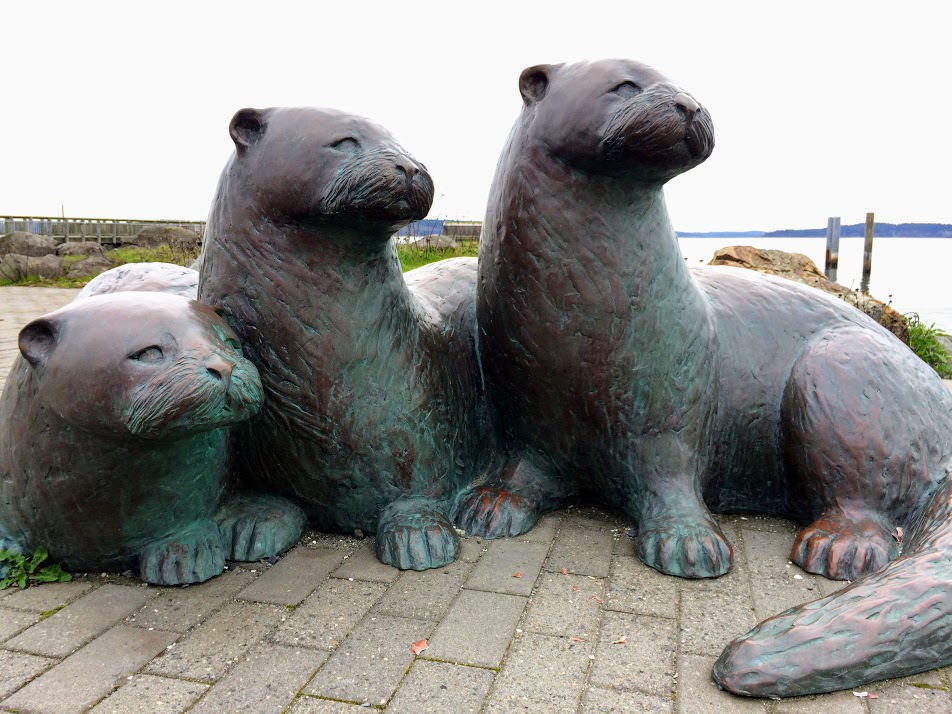 Three Otters sculpture, 2011 by Georgia Emery, outside the NW Maritime Center and Velocity coffee shop.