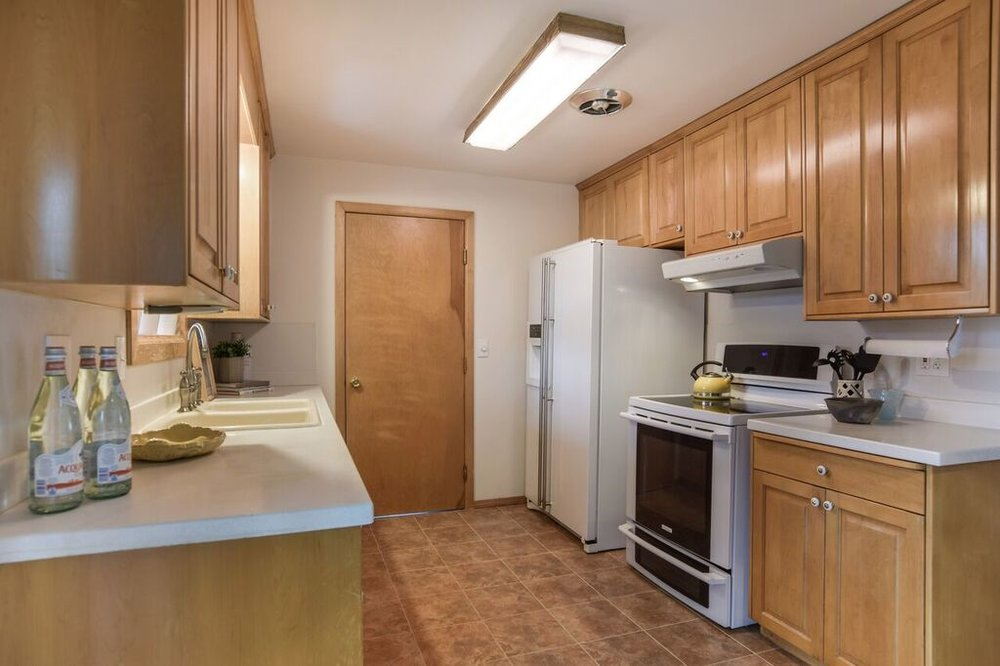 Bright kitchen with a window over the sink overlooking the big backyard. Door enters into the attached garage.