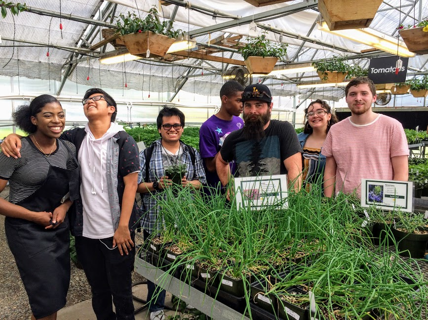 Mr. Iverson and a group of Plant Biology Students in the east greenhouse at Abe's Golden Acres.