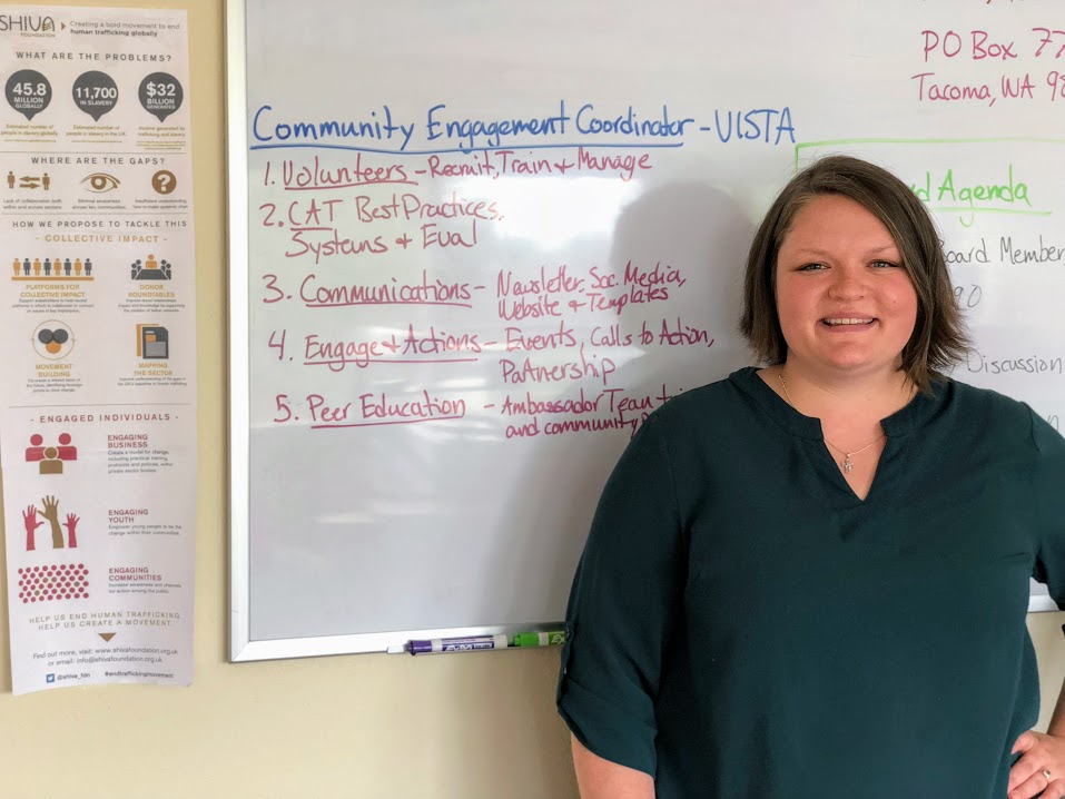 Kerri in front of the working white board at the WTP Office in Tacoma, WA.