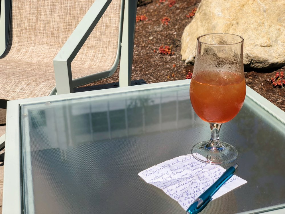 Honeypunch (so nice!) and a few moments for scribbling notes on a scrap of paper on the courtyard patio at Honey.