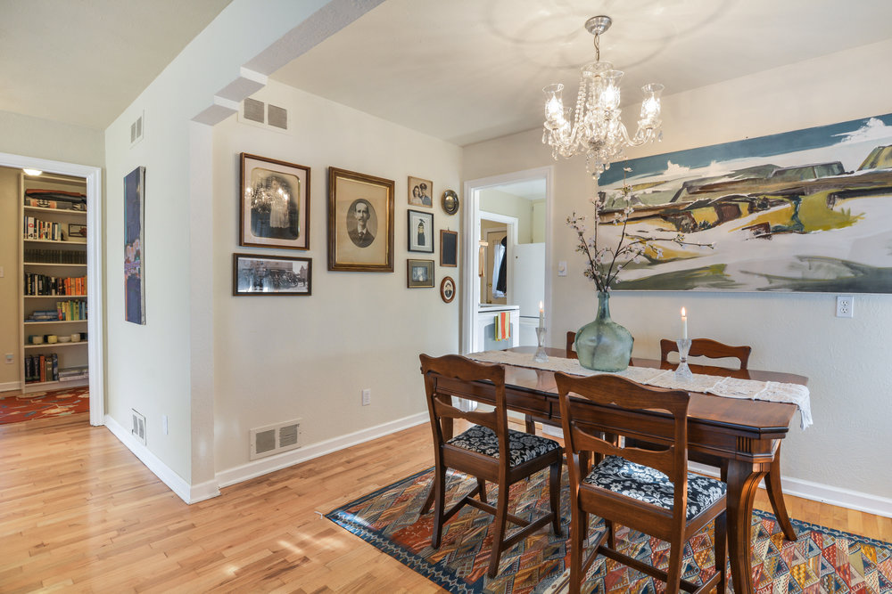 The dining room is open to the kitchen, but has its own sense of space defined by the stepped arch above.