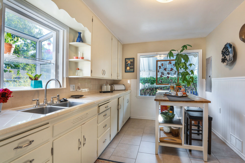 The kitchen overlooks the back yard and features a box window for herbs and houseplants.
