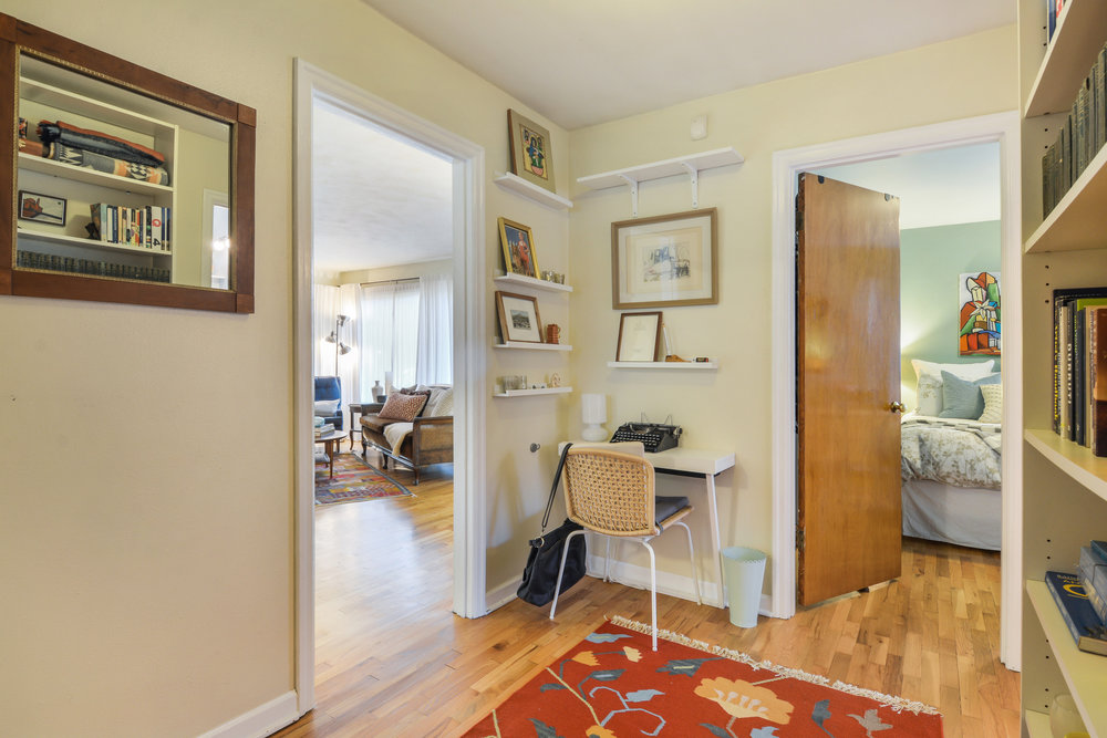 A spacious hallway connects the living room to the bedrooms and bathroom. This hall also leads into the laundry/mudroom which opens into the kitchen, and has a door to the backyard. This cute hall is the connector!