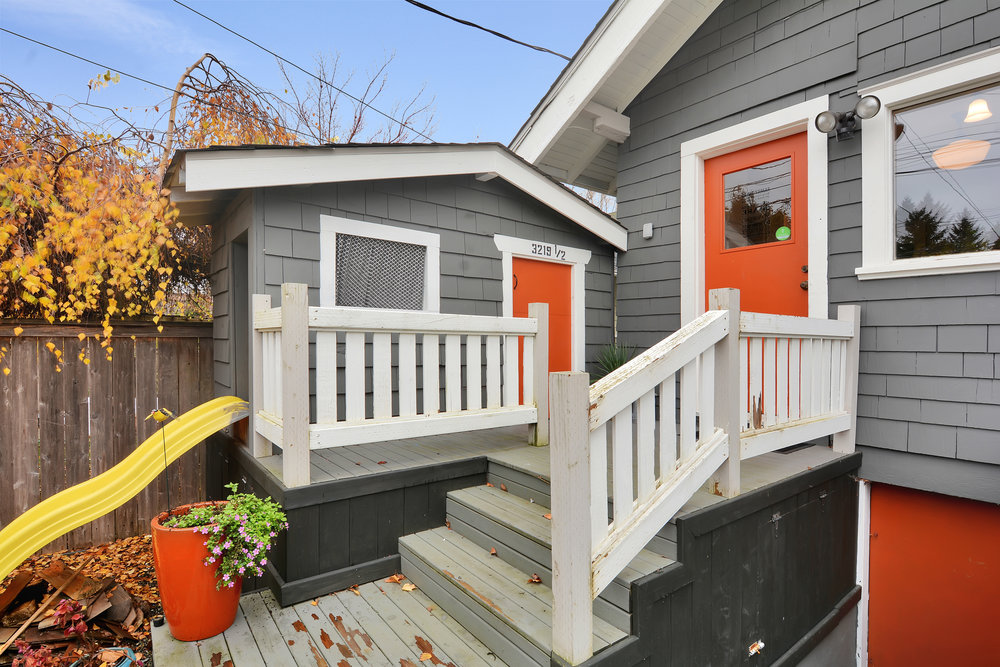Just outside the back kitchen door you'll find the matching custom playhouse with its own slide.