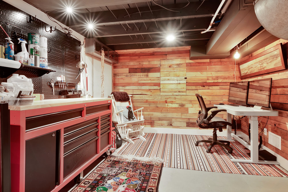 Another section of the finished basement functions as a workshop and office space.