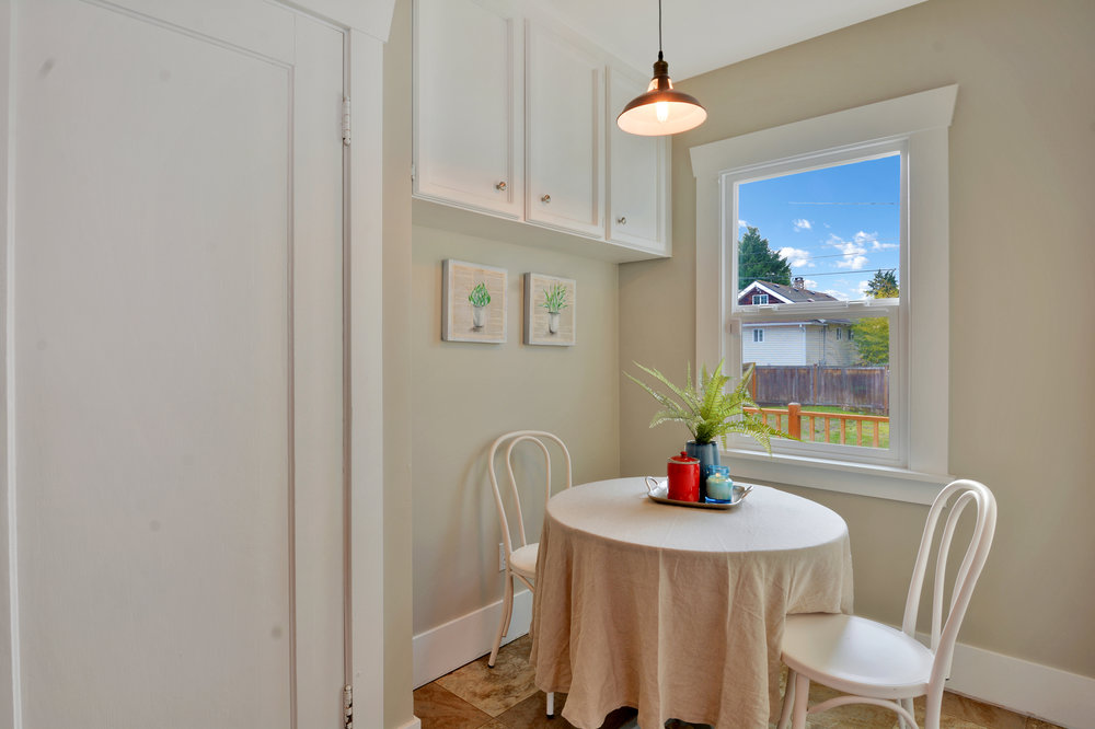 The kitchen is complete with a breakfast nook overlooking the back yard.