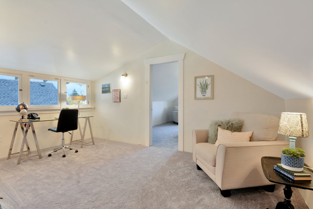 At the top of the stairs brand new carpet covers this additional living space with its set of north facing windows.