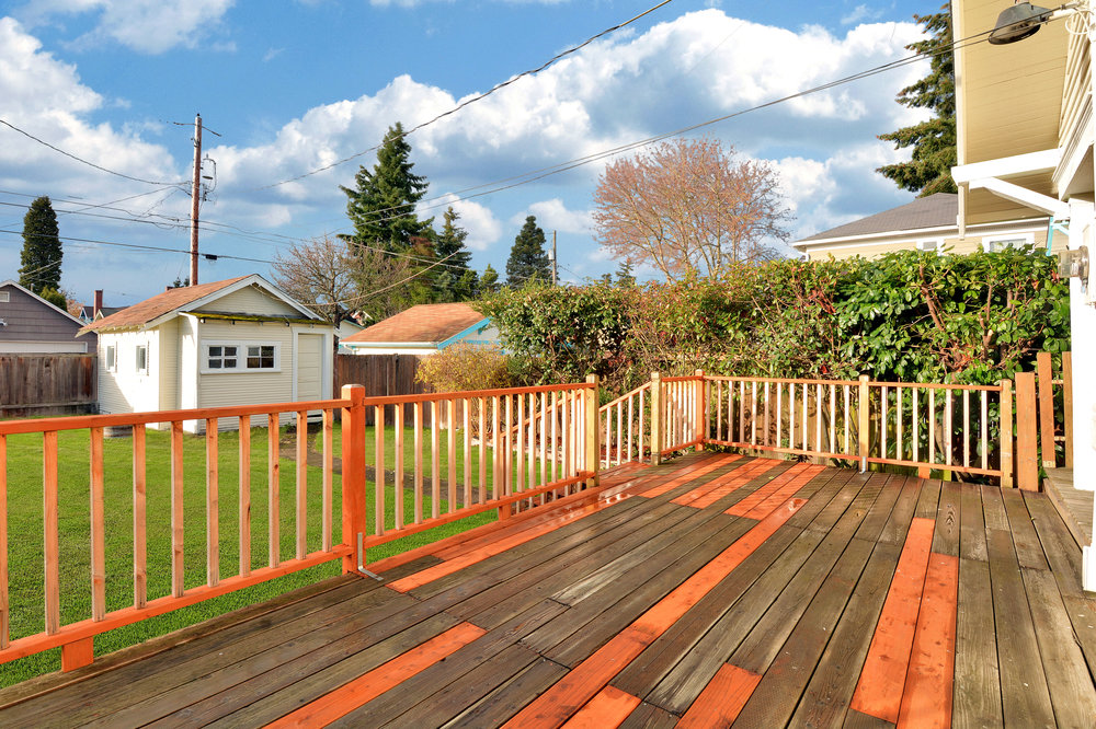 A wooden deck right outside the kitchen door offers a great place to barbecue and set up the patio furniture.
