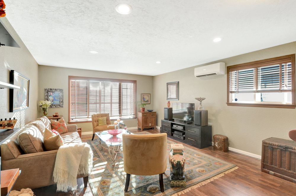 This renovated family room features dimmable recessed lighting and high-quality, lifetime-warranty laminate flooring. So much extra space added to the home with this room.