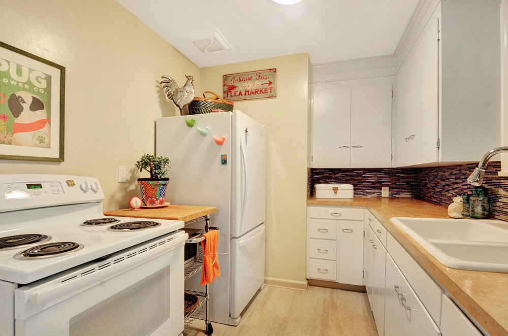 Fresh paint, new stove, new counters, and new floor, along with the pretty backsplash make this kitchen cooking-ready.