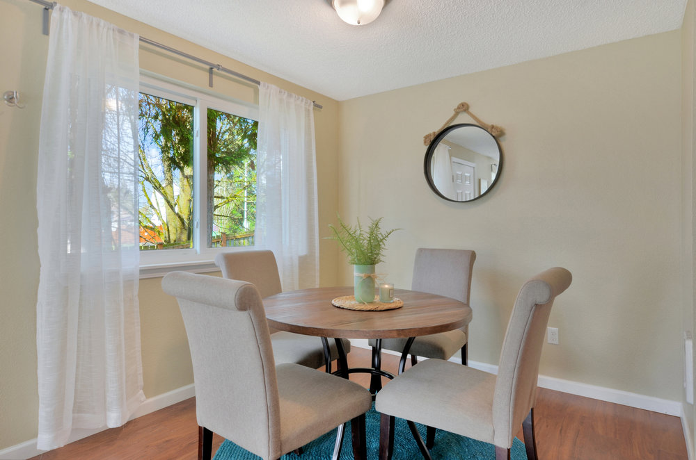 The dining room overlooks the yard set high up above J Street. Engineered hardwood floors and freshly painted walls complete the room.