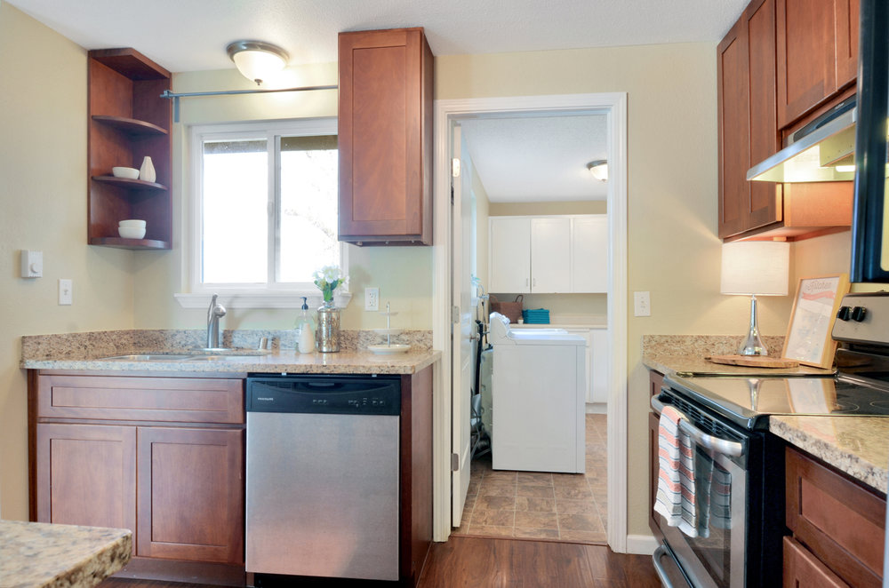 A truly convenient feature of this home is the laundry room with pantry shelves located just outside the kitchen.