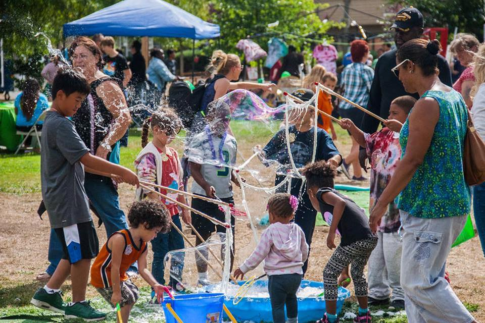 Image from    Hilltop Street Fair.     Get in on the annual street fair in August!