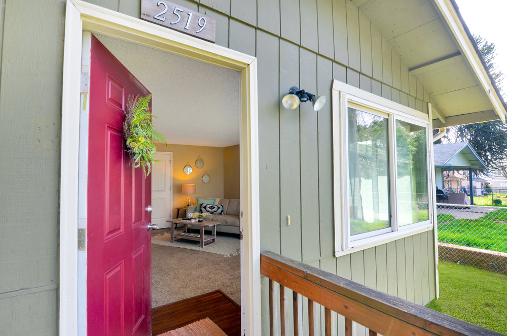 West facing front of 2519 S J, a cozy rambler set high above J Street for privacy and quiet.