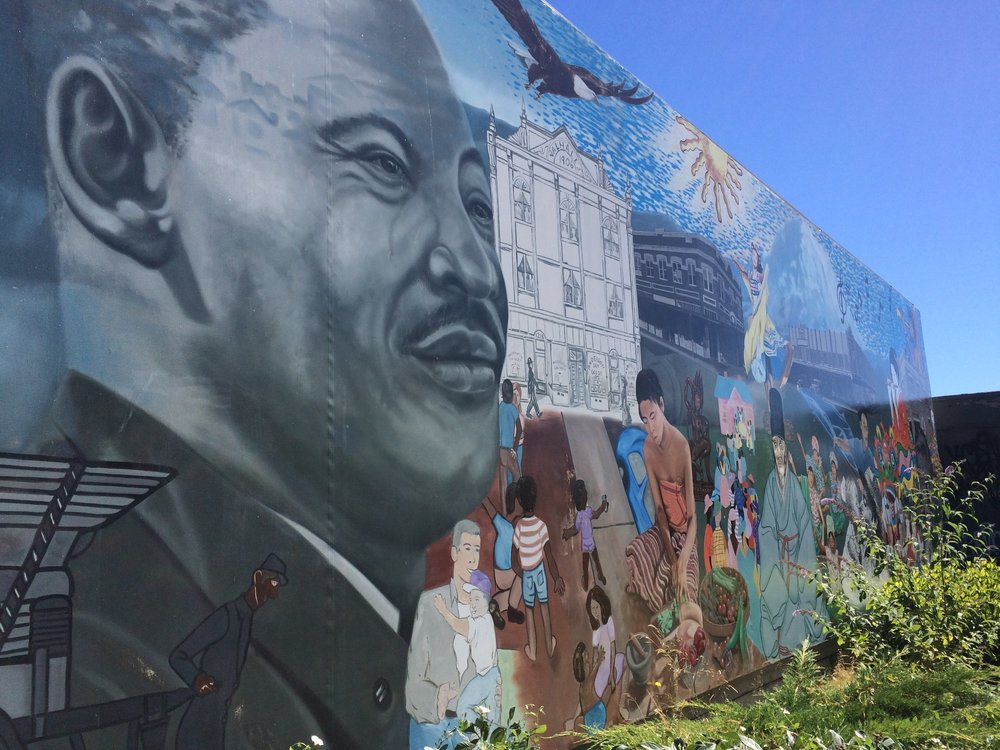 """""""Dream Coming True"""" mural by Bob Henry at S 9th & Martin Luther Kind Jr. Way."""